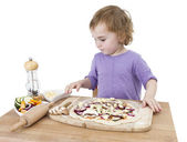 Preschooler making fresh pizza — Stock Photo