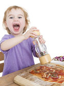 Happy child making pizza — Stock Photo