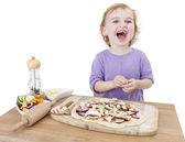 Laughing child with home made pizza — Stock Photo