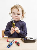 Child choosing tool for repairing hard drive — Stock Photo