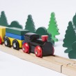 Wooden toy train in rural landscape — Stock Photo #38006539