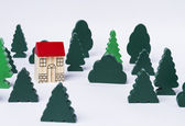 Toy house in forest — Stock Photo