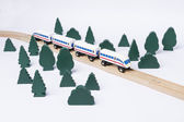 Fast train driving through small forest — Stock Photo