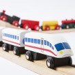 Wooden toy trains on railway — Стоковое фото