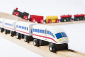 Wooden toy trains on railway — Stock Photo