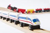Wooden toy trains on railway — Stock Photo