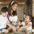 Attractive Family Baking and Eating Cookies In A Kitchen — Stock Photo #13806404