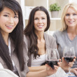 Interracial Group Three Women Friends Drinking Wine - Stock Photo