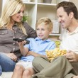 Happy Family Sitting on Sofa Watching Television — Stock Photo