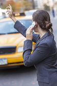 Young Woman on Cell Phone Hailing a Yellow Taxi Cab — Stock Photo