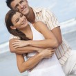 Man and Woman Couple Embracing On A Beach — Stock Photo #13810749