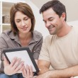 Happy Man & Woman Couple Using Tablet Computer at Home — Stock Photo