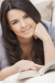 Happy Hispanic Woman Reading Paperback Book — Stock Photo
