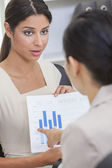 Woman or Businesswoman in Meeting with Graph — Stock Photo