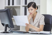 Asian Chinese Woman or Businesswoman in Office — Stock Photo