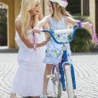 Stock Photo: Mother Parent & Girl Child Riding Bike