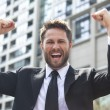Young Successful Business Man Celebrating in City — Stock Photo