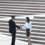Asian Woman Caucasian Businessman Handshake City Steps — Stock Photo #31691767