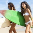 Stock Photo: Beautiful Bikini Women Surfers & Surfboards At Beach