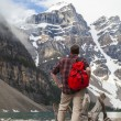 Hiking Man Looking at Moraine Lake & Rocky Mountains — Stock Photo #31695933