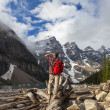 Hiking Man Looking at Moraine Lake & Rocky Mountains — Stock Photo