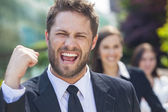 Successful Business Man Celebrating With Female Team — Stockfoto