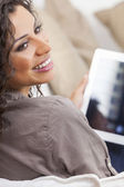 Hispanic Woman Laughing Using Tablet Computer — Stock Photo