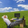 Businessman Relaxing Feet Up Desk in Green Field — Stock Photo #38622727