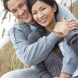 Stock Photo: Asian Romantic Couple on Beach Dunes