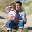Father and son in sand dunes — Stock Photo #42389673