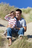 Father and son in sand dunes — Stock Photo