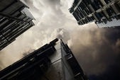 Low angle view of Hong Kong housing with storm clouds — Stock Photo