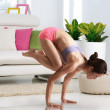 Asian Chinese woman performing yoga at home — Stock Photo