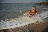 Asian Retiree in his 60s in outdoor sea sports — Stock Photo