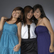 3 teengage asian chinese girls in various poses — Stock Photo #6548610