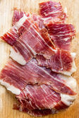 Spanish iberico ham slices closeup — Stock Photo
