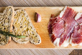 Spanish ham with toasts — Stock Photo