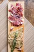 Spanish ham with toasts, top view — Stock Photo