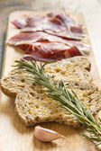 Spanish ham with toasts, focus on toasts — Stock Photo