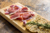 Spanish ham with toasts, focus on ham — Stock Photo