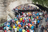 Marathon runners in paris — Stock Photo