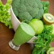 Green smoothie, green fruits and green vegetables - Stock Photo