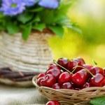 Cherry (fruit) in the wicker basket — Stock Photo #24387639