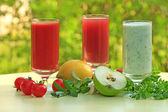 Three different smoothies made of fruits and vegetables — Stock Photo