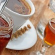 Stock Photo: Plum brandy, coffee, strawberry jam and water