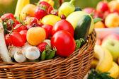 Basket full of organic fruit and vegetables — Stockfoto