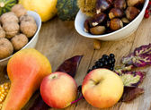 Autumn fruits on the table — Stock Photo