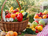 Wicker basket full of fresh fruits and vegetables — Stock Photo