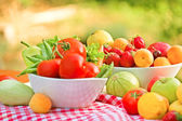 Fresh organic fruits and vegetables on a table — Stock Photo