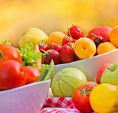 Fresh organic fruits and vegetables in a bowls — Stock Photo